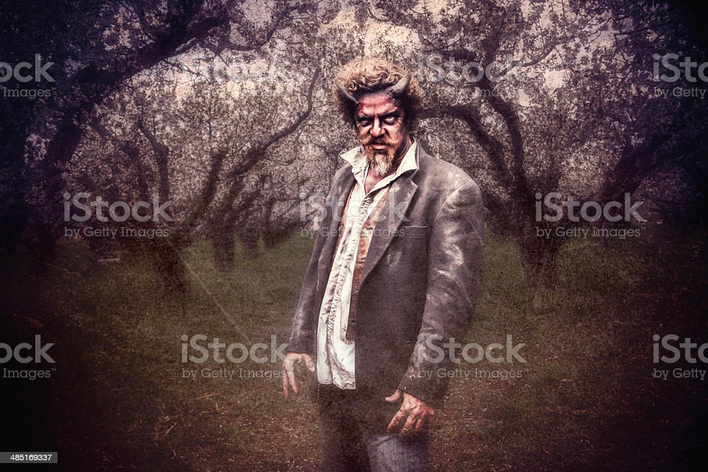Devil in an Orchard stock photo