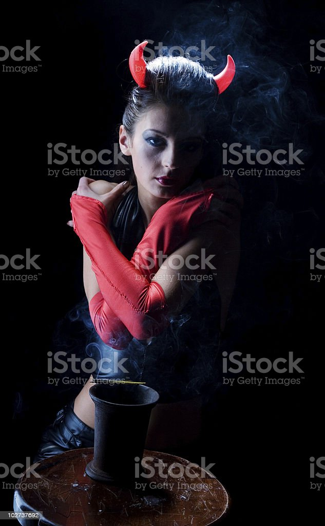 devil in the clouds of smoke from incense royalty-free stock photo