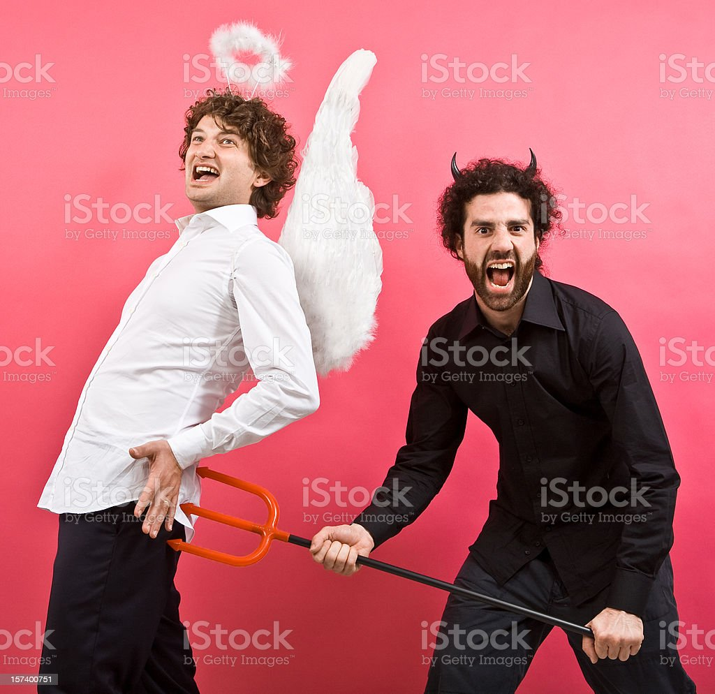 devil joke to surprised angel royalty-free stock photo