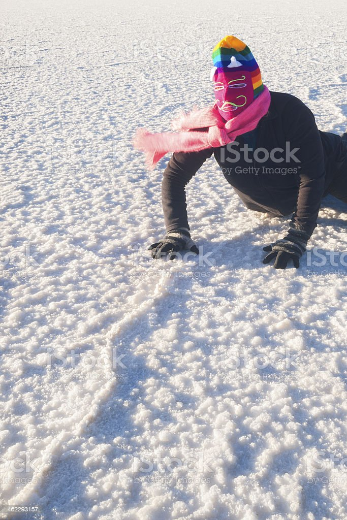 devil masked person in salt flats stock photo