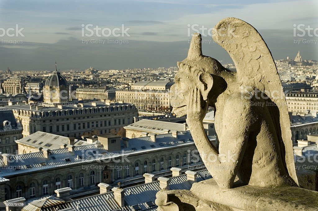 Devil overlooking Paris royalty-free stock photo