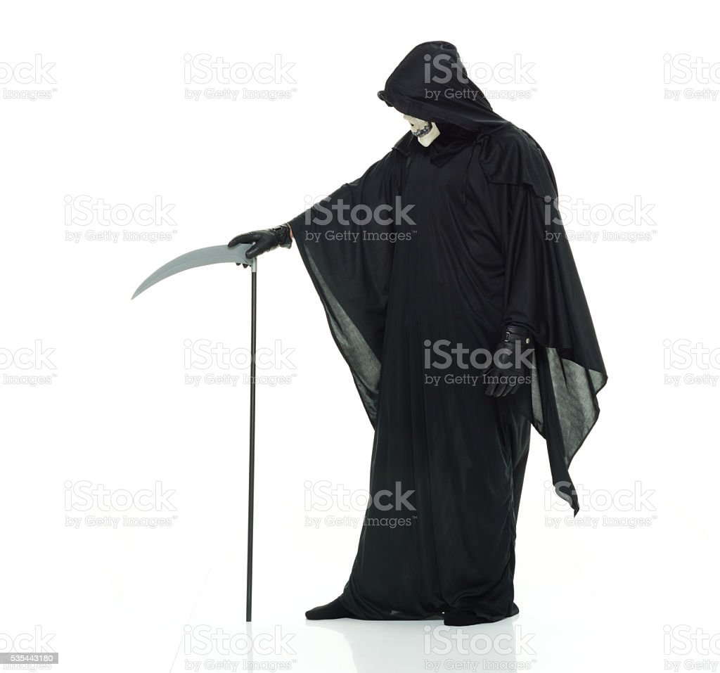 Devil posing with scythe stock photo