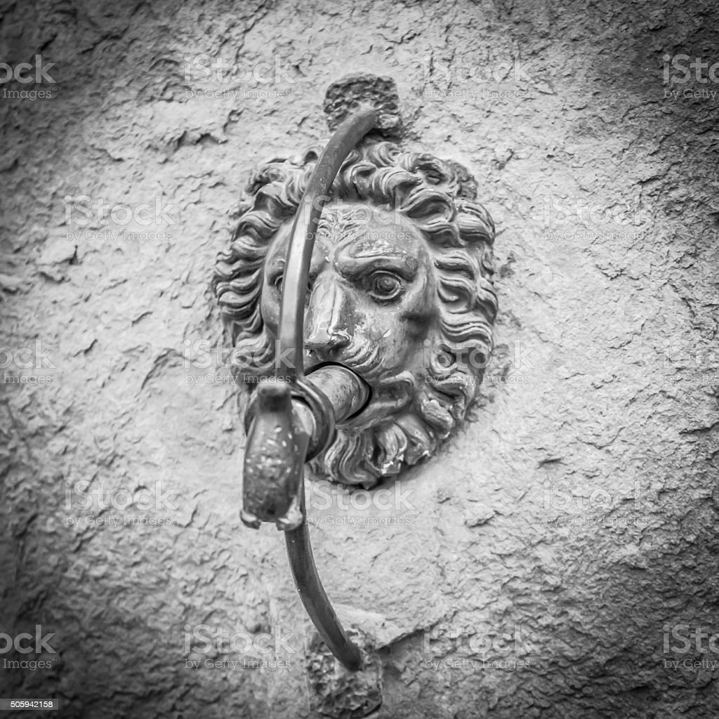 Devil stone on the wall stock photo