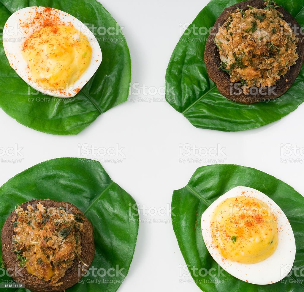 Deviled eggs and Stuffed mushrooms royalty-free stock photo