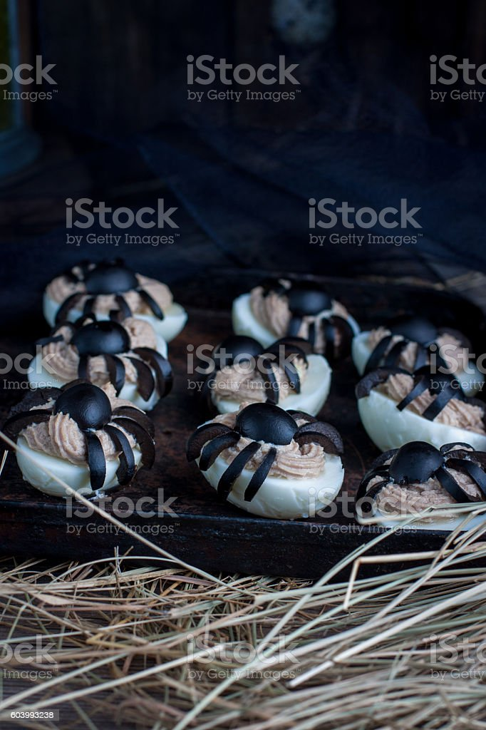 Deviled eggs with a Spider for Halloween stock photo