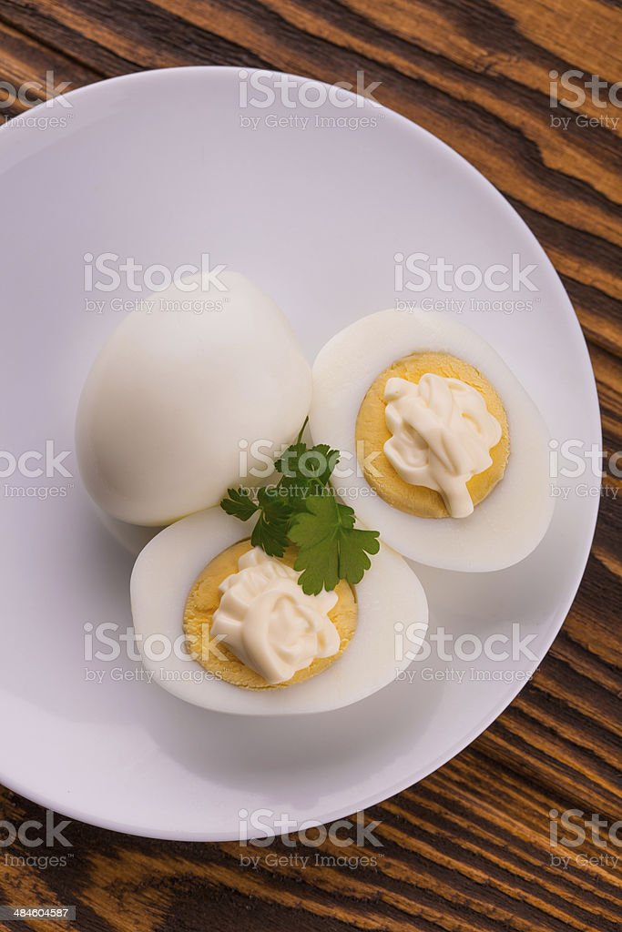 Deviled eggs with parsley in a plate stock photo