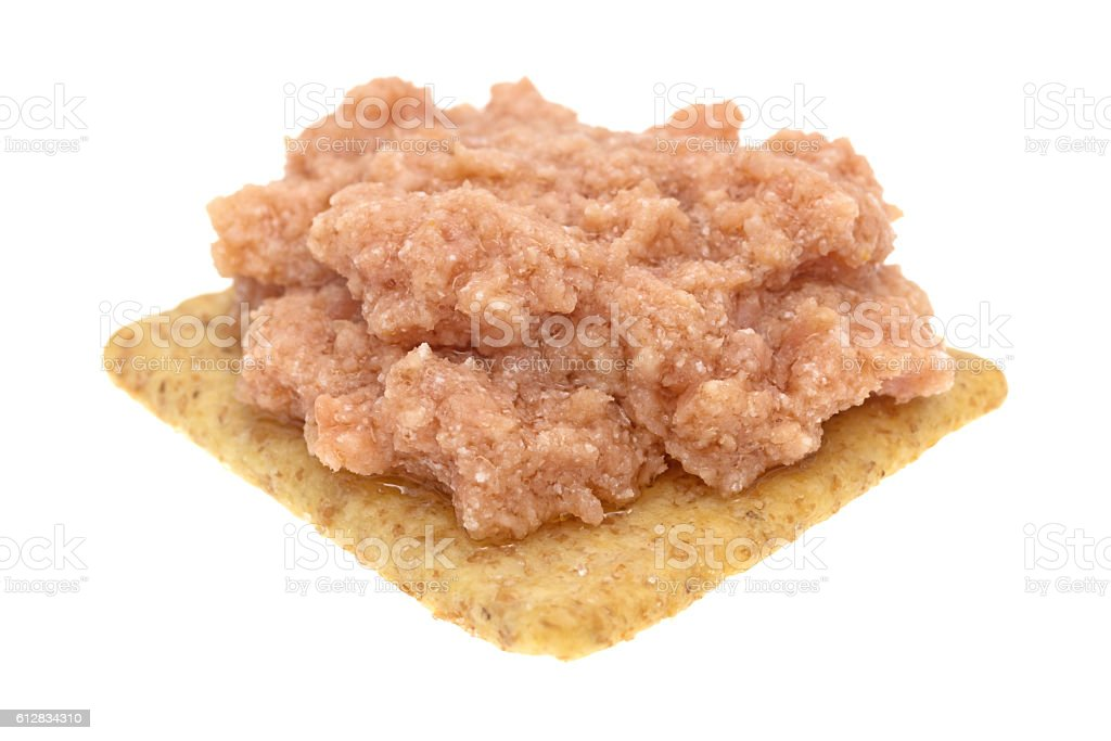 Deviled ham a whole wheat cracker stock photo