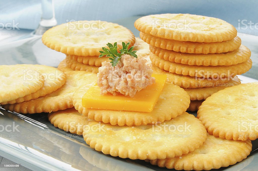 Deviled ham and cheese on a cracker stock photo