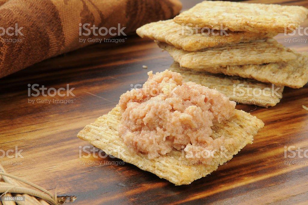 Deviled ham on crackers stock photo