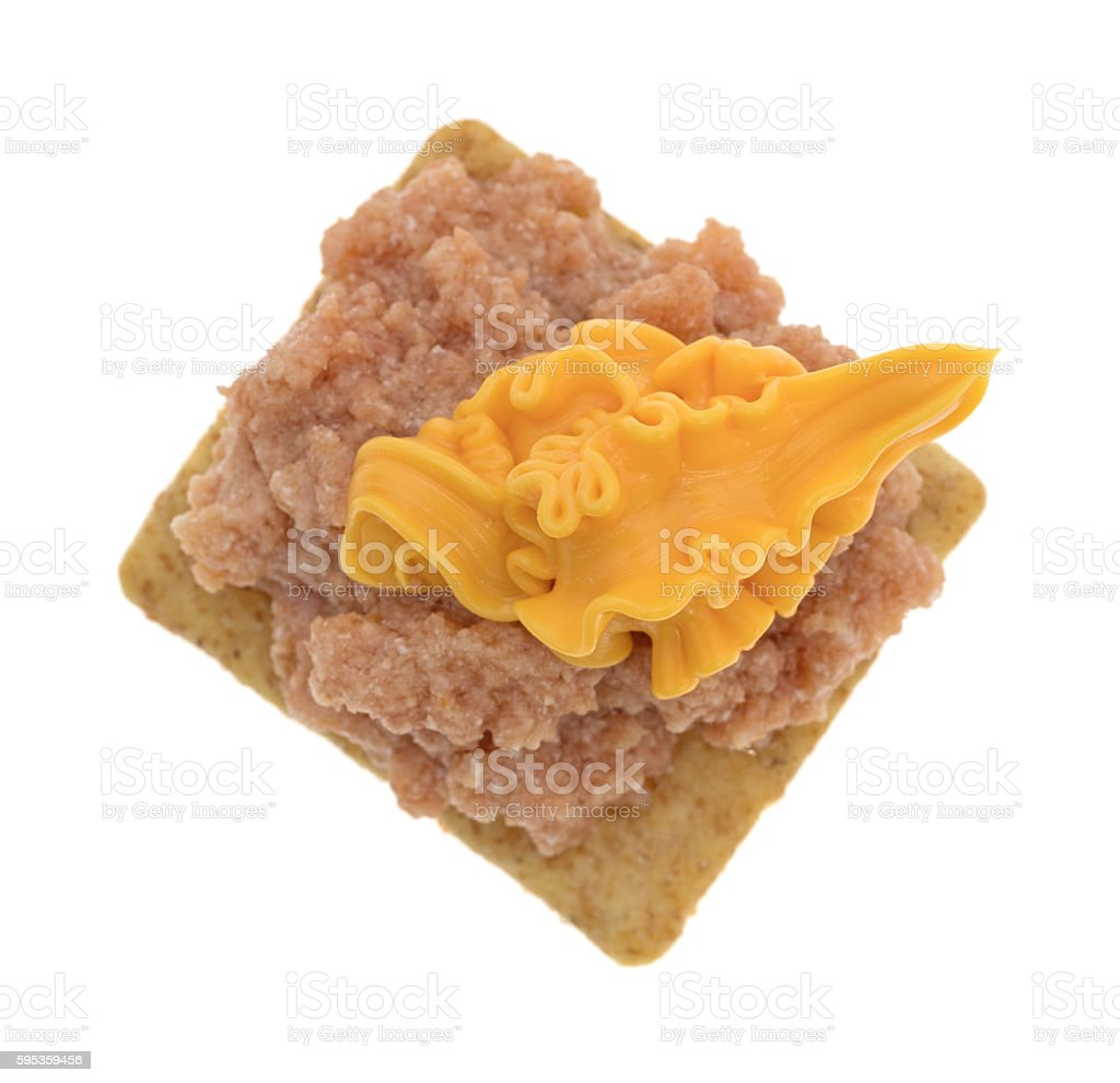 Deviled ham with canned cheese on a cracker stock photo