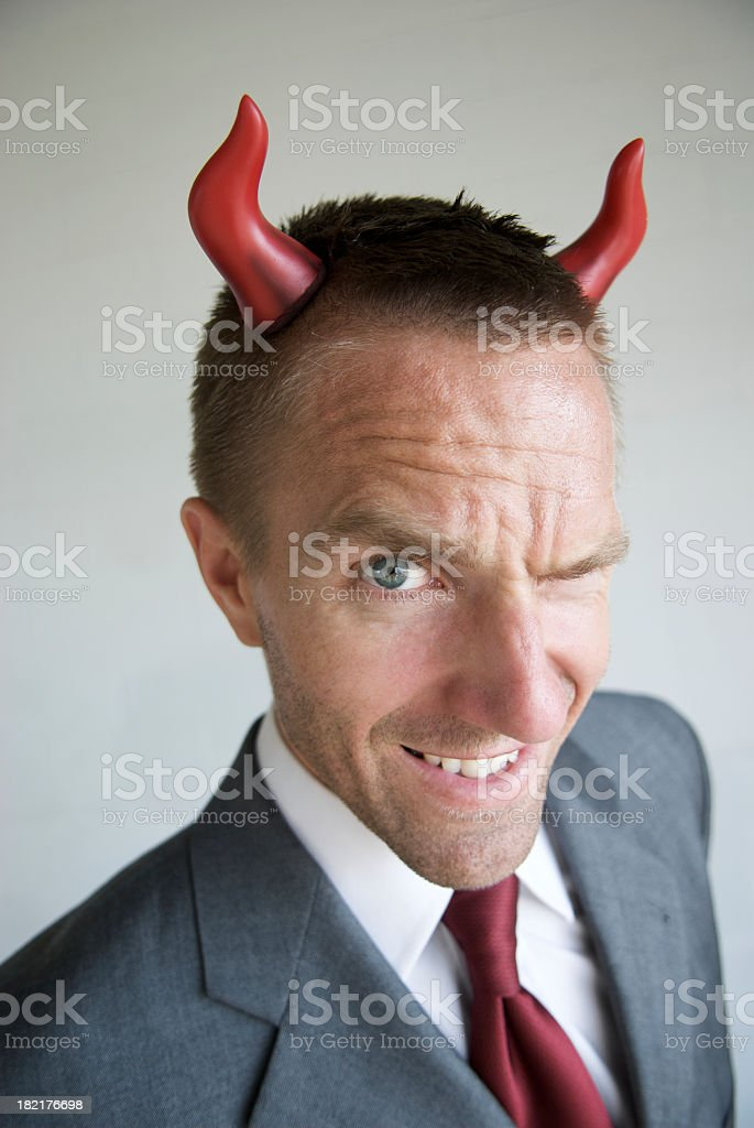 Devilish Horny Businessman With Mischief in His Eyes stock photo