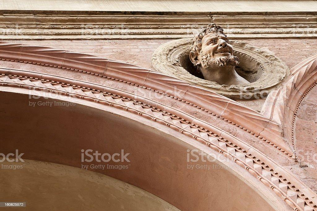 Devil-like wall ornament royalty-free stock photo