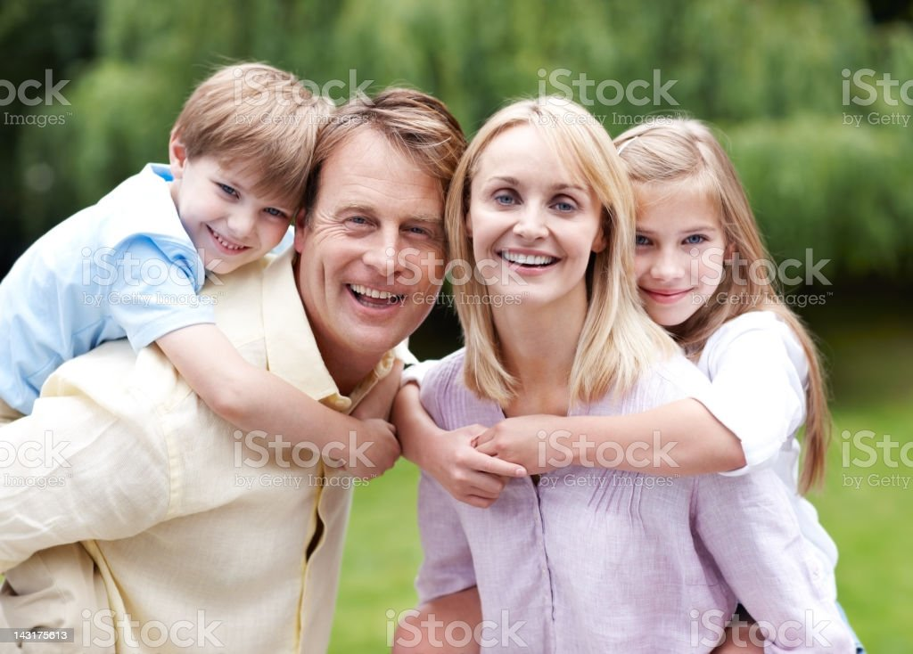 Devoted parents and their adoring children royalty-free stock photo