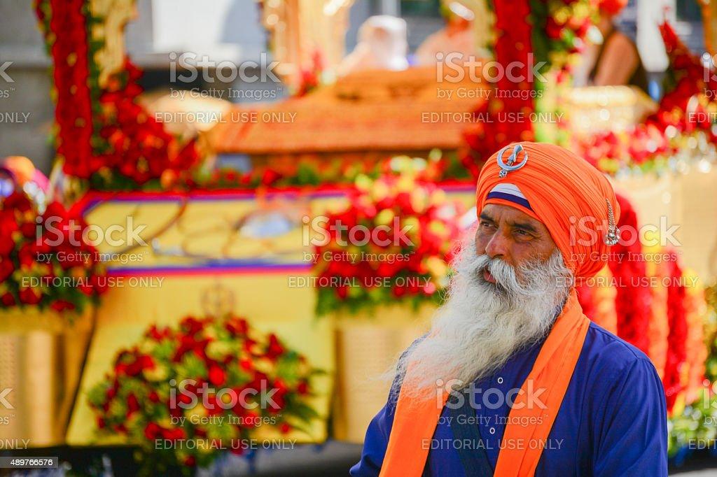Devotee Sikhs with orange turban marching stock photo