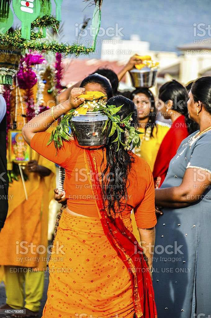 Devotees carrying pot of milk during Thaipusam stock photo
