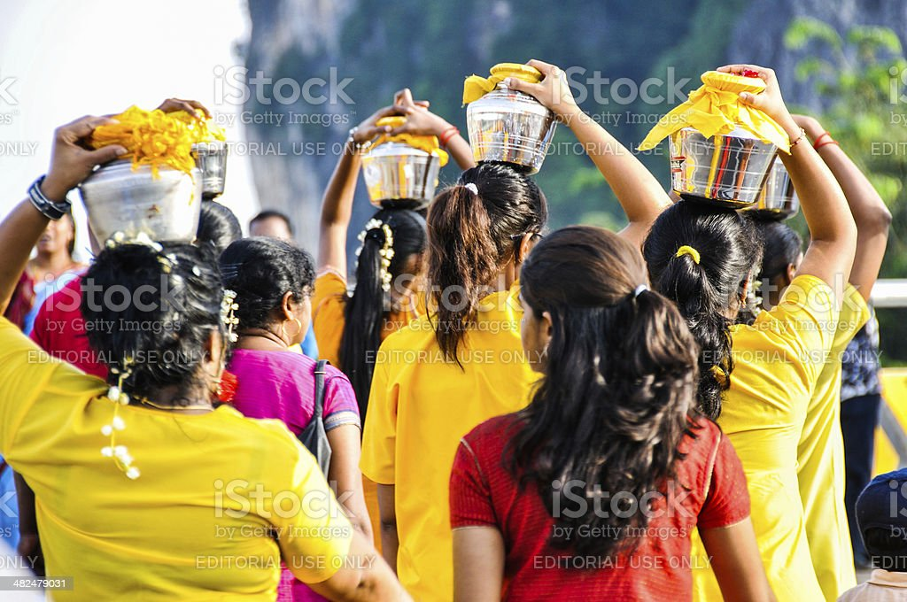 Devotees carrying pots of milk during Thaipusam stock photo