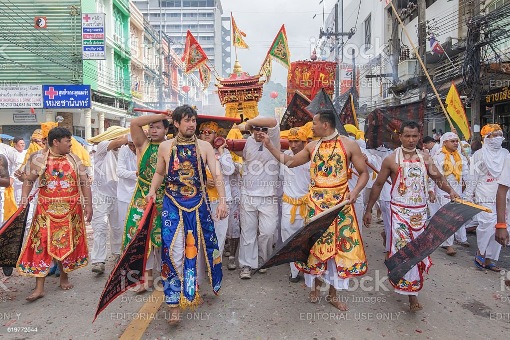 Devotees of a Chinese shrine carry a palanquin housing stock photo