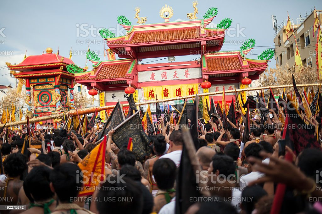 Devotees take a part in a vegetarian festival in Phuket stock photo