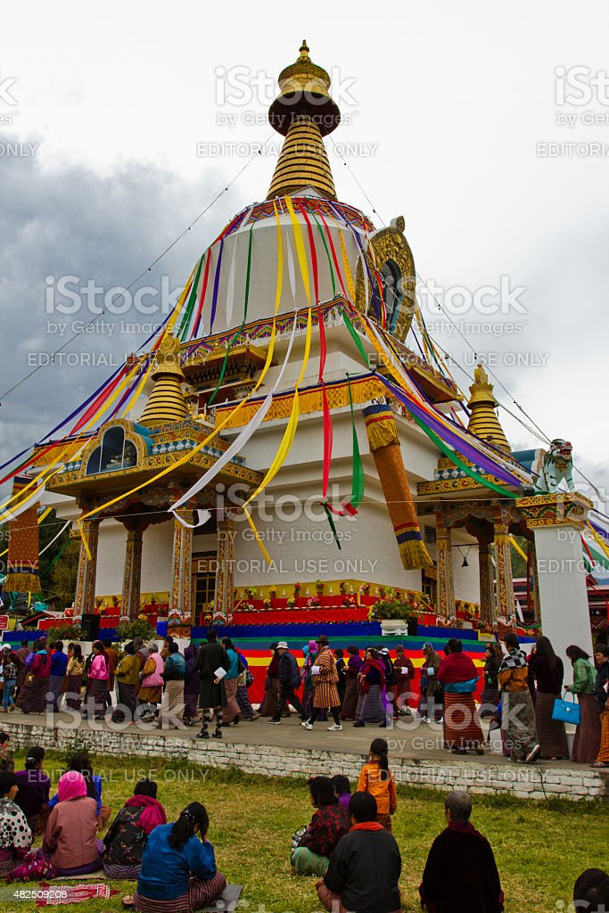 Devotees walk around The Memorial Stupa of Thimphu, Bhutan stock photo