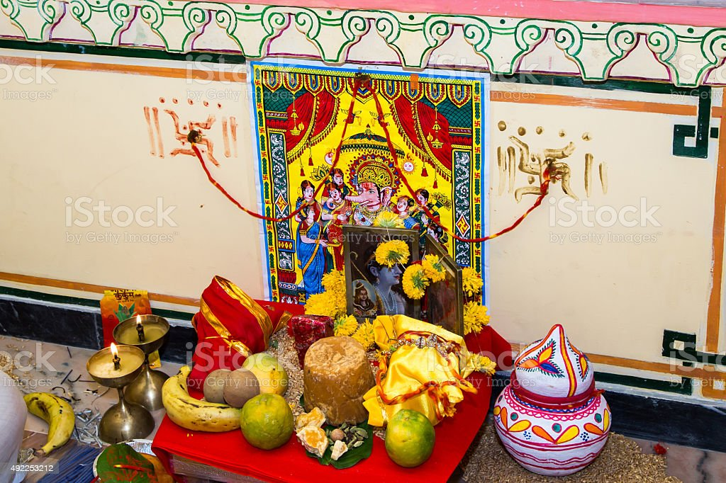 devotion and invitation for lord ganesha at an indian wedding stock photo