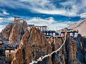 Dhankar gompa Tibetan Buddhist monastery and prayer flags lungta