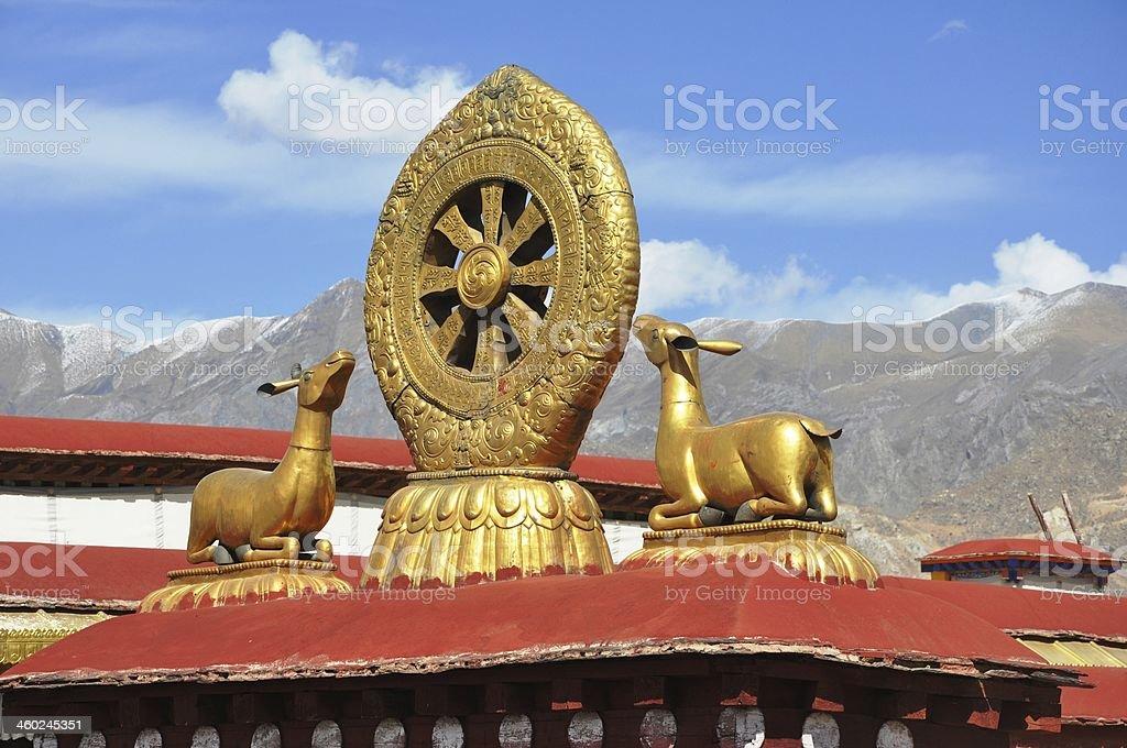 Dharma wheel and two deers stock photo
