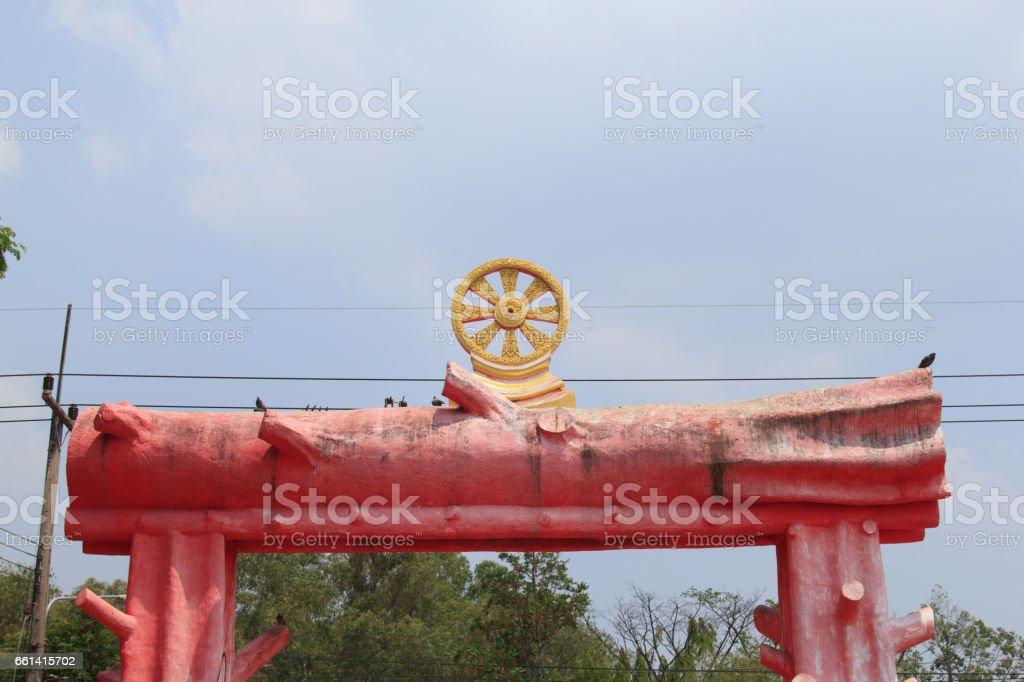 Dharma Wheel on The statue of Wood log, stock photo