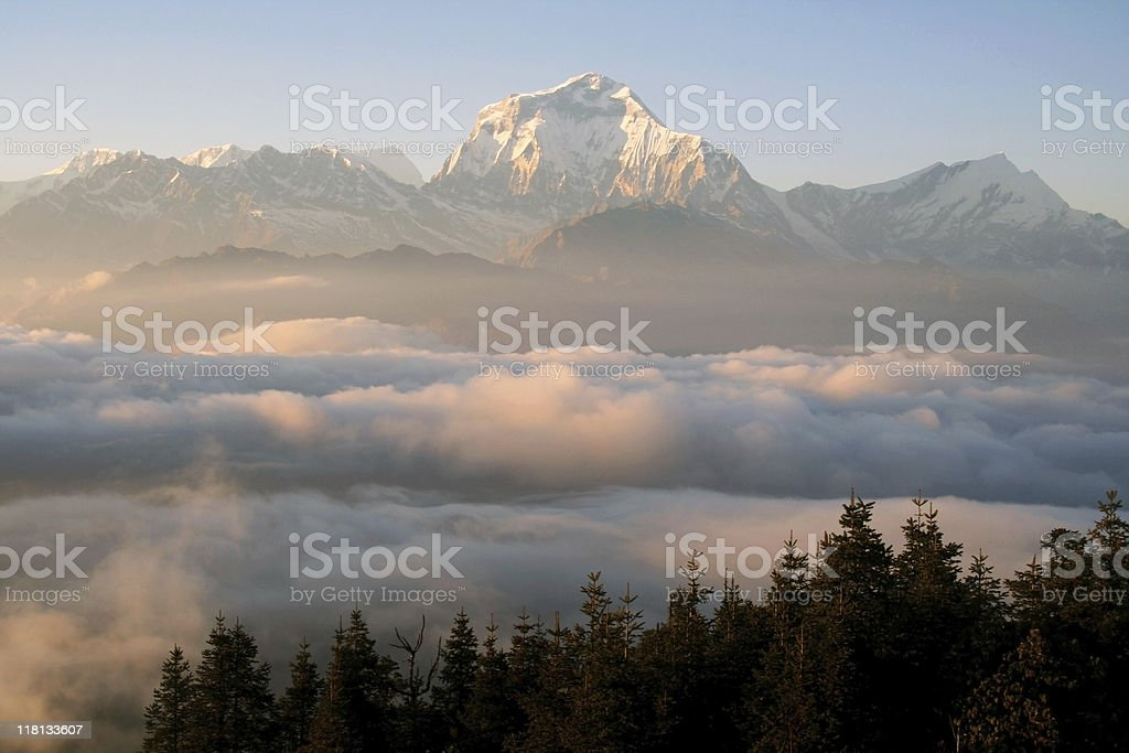 Dhaulagiri mountain ranges rises above the clouds royalty-free stock photo