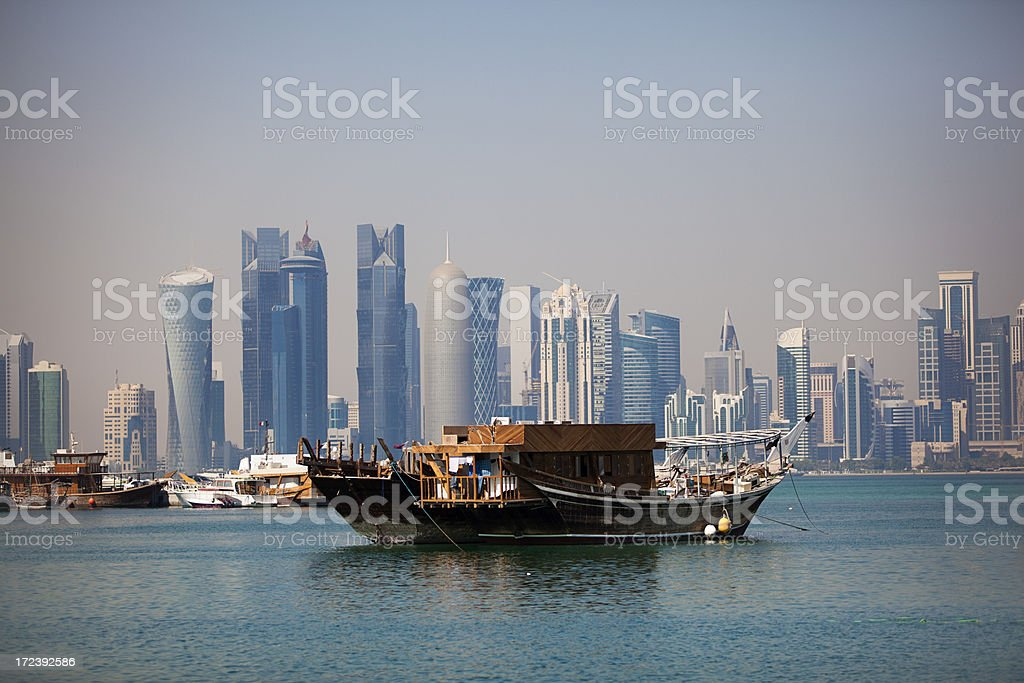 dhow and doha skyline stock photo