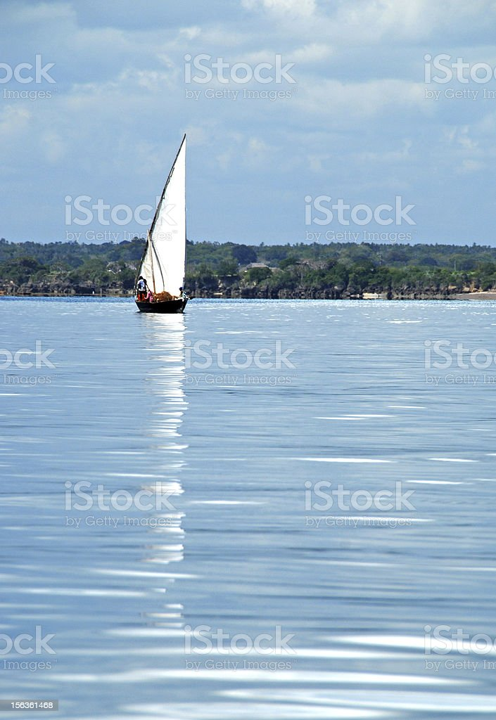 Dhow and Reflection on Calm Indian Ocean royalty-free stock photo