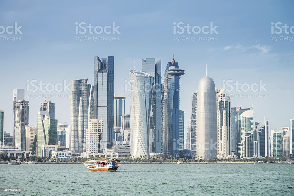 Dhow in Front of Modern Doha Skyline, Qatar stock photo