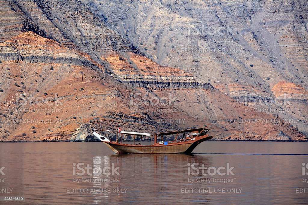 Dhow in front of the Musandam coast, Oman stock photo