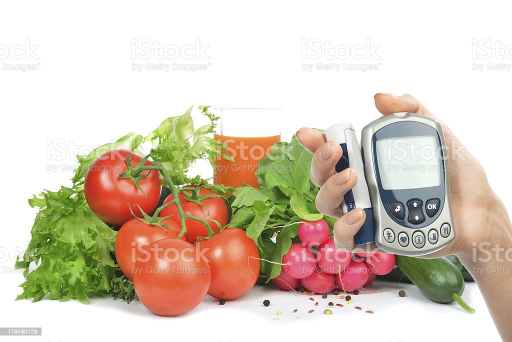 Diabetes concept glucometer and healthy food royalty-free stock photo