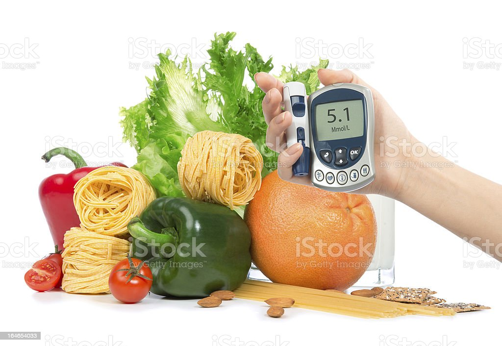 Diabetes concept glucose meter in hand fruits, vegetables royalty-free stock photo