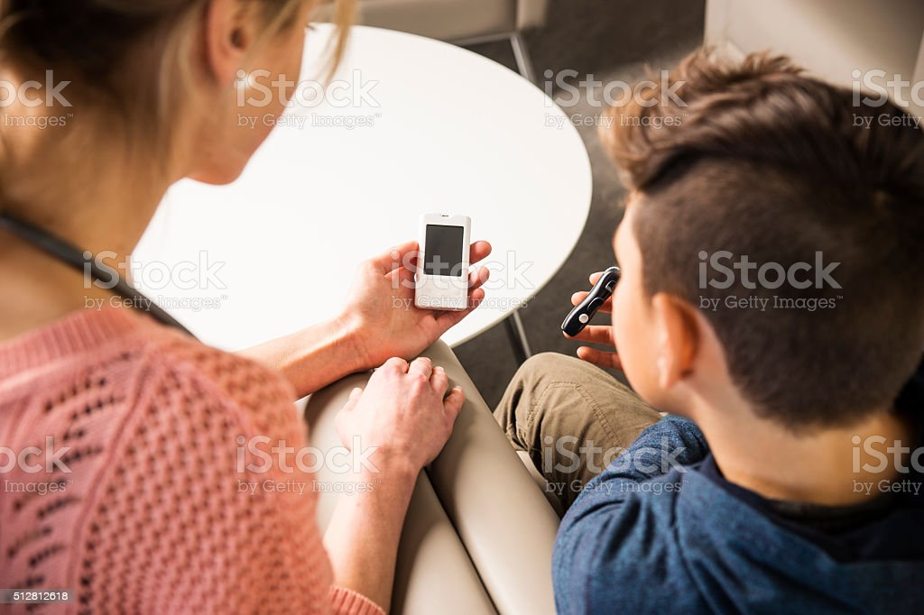 Diabetes consultation with specialist and a young patient stock photo
