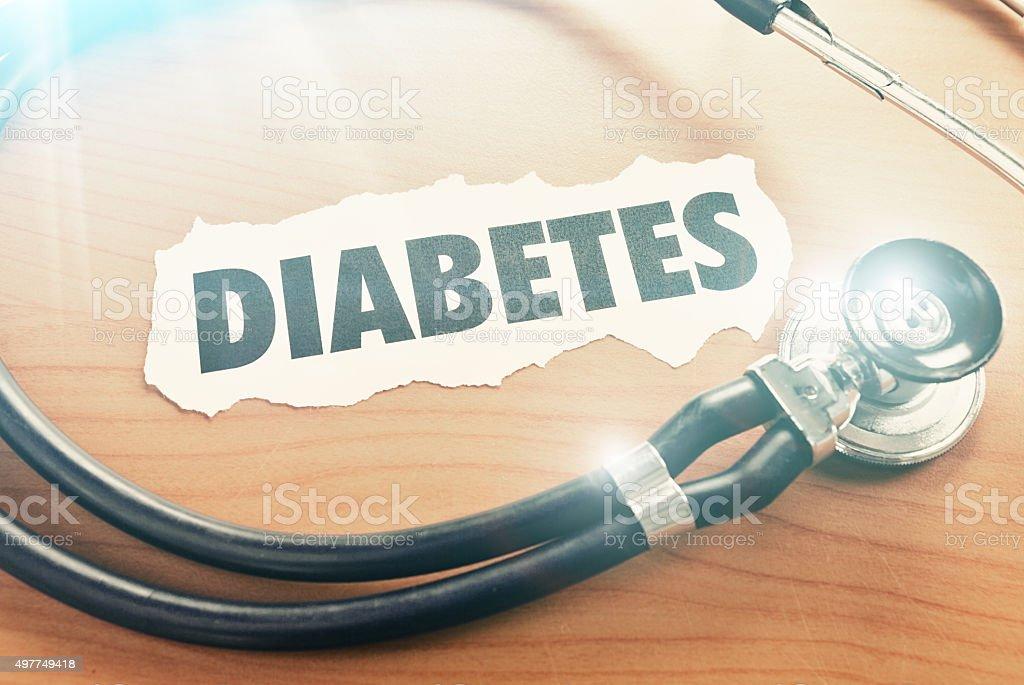 Diabetes headline with stethoscope stock photo