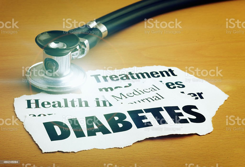 Diabetes headlines with stethoscope showing lens flare stock photo