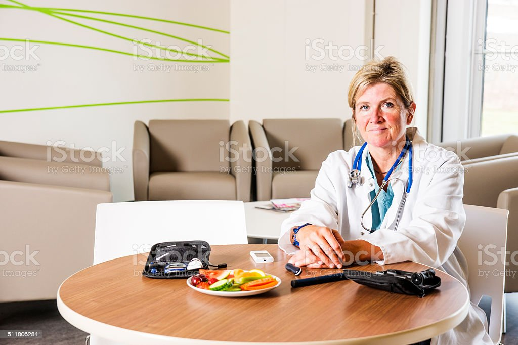 Diabetes health care specialist with a testing devices stock photo