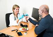 Diabetes healthcare specialist with patient