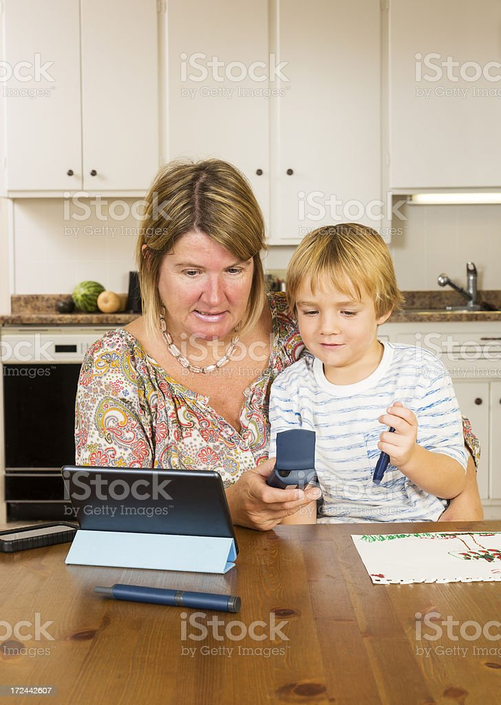 Diabetes patient checking blood glucose levels stock photo