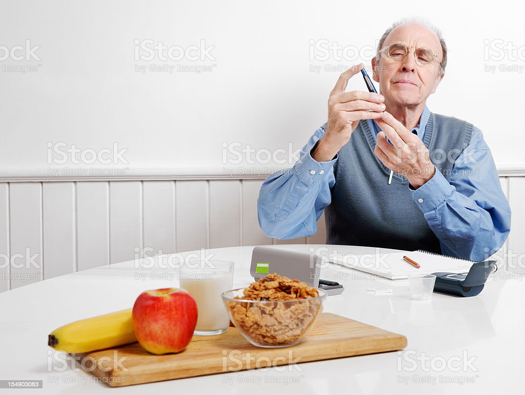 Diabetes patient testing his blood sugar stock photo