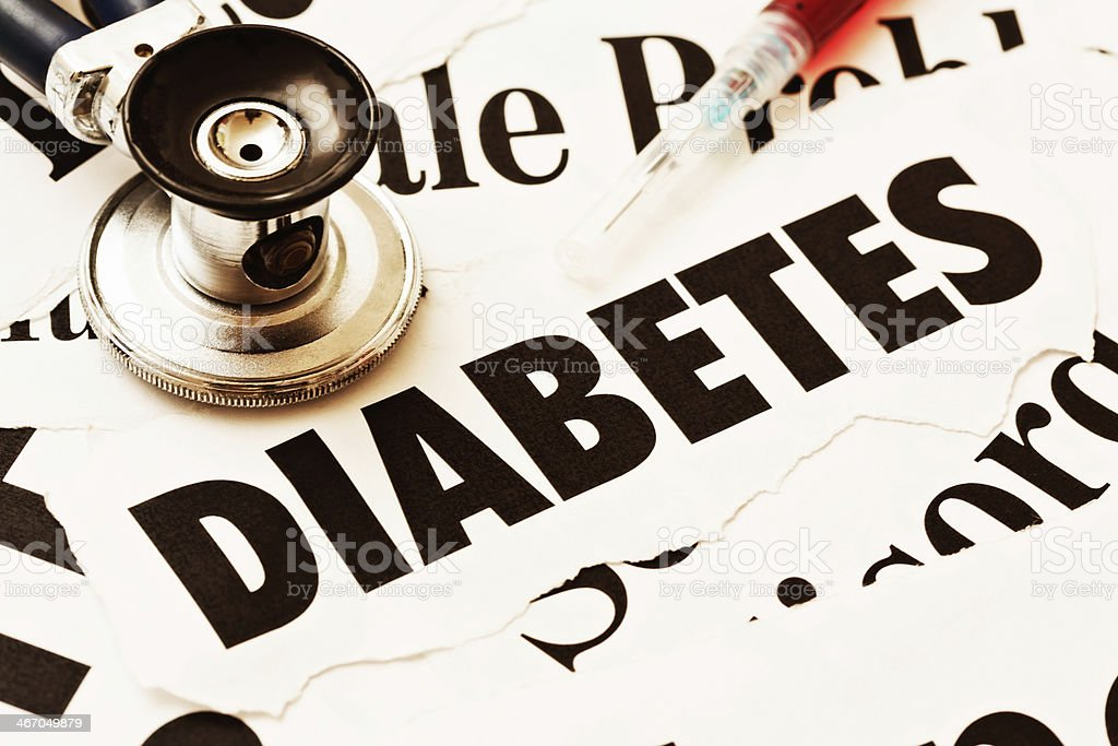 Diabetes related headlines with hypodermic and stethoscope stock photo