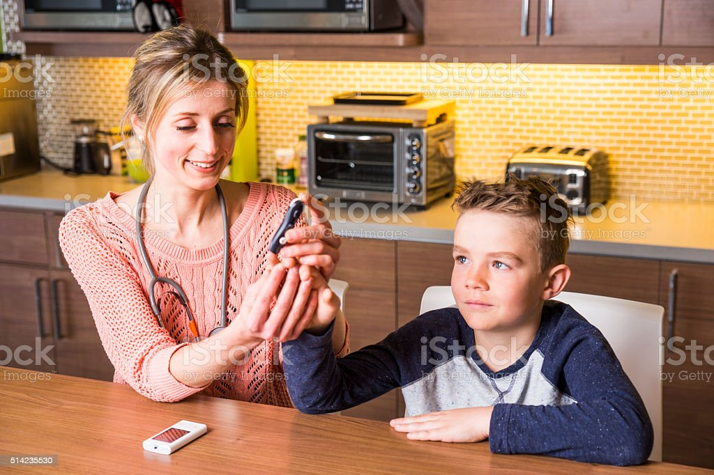 Diabetes specialist with a young Type One patient stock photo