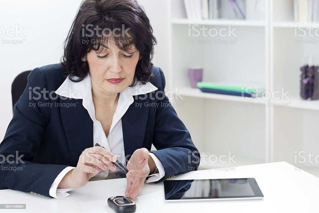 Diabetes test in the office royalty-free stock photo