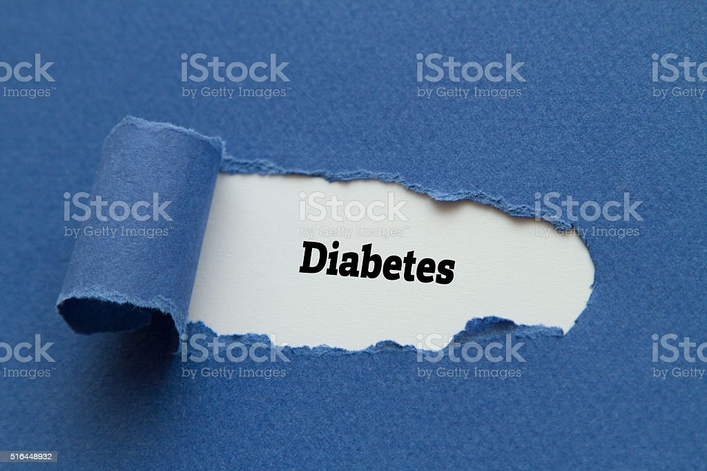 Diabetes word written behind torn paper. stock photo