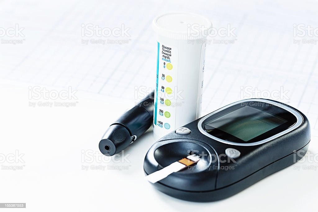 Diabetic diagnostic equipment: glucometer, test strips and lancet stock photo