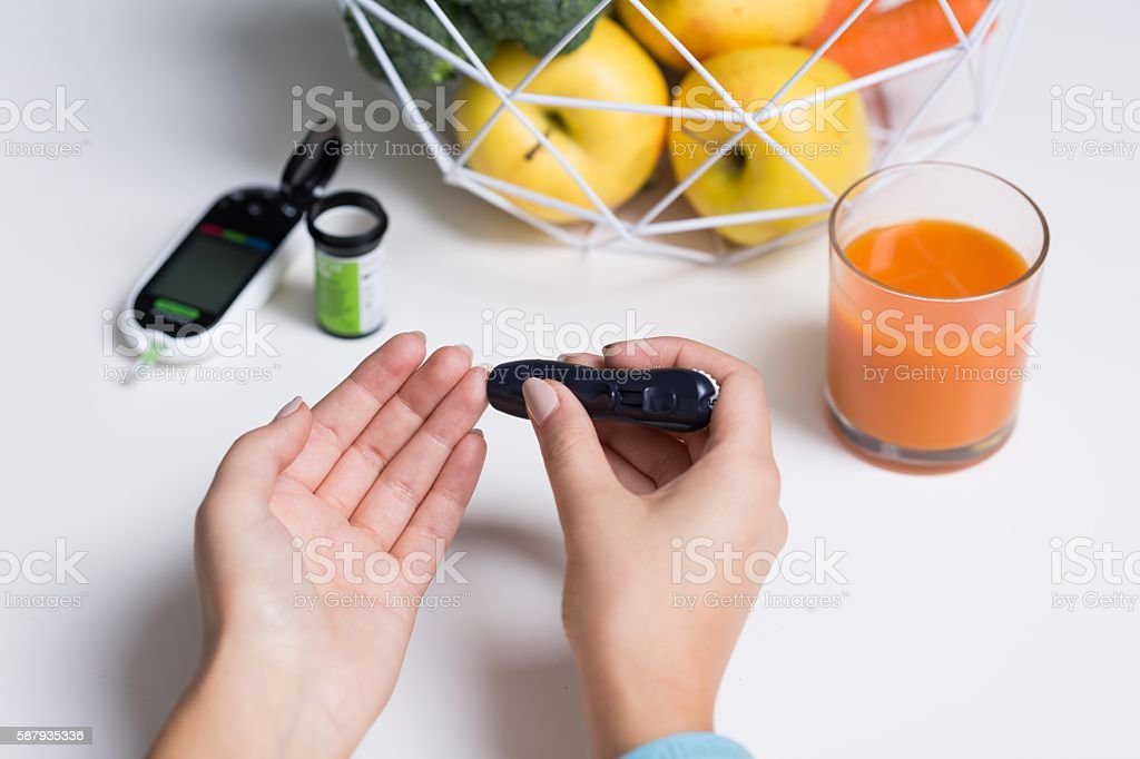 Diabetic doing glucose test stock photo