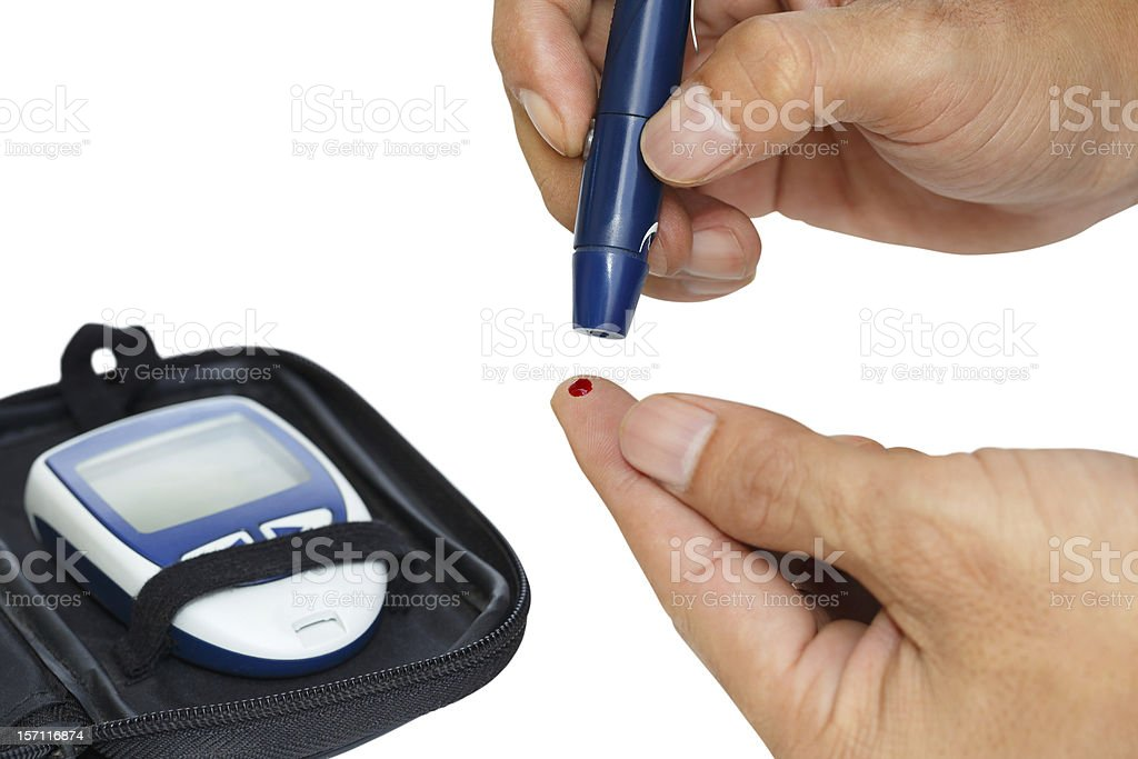 Diabetic lancet device in hand royalty-free stock photo