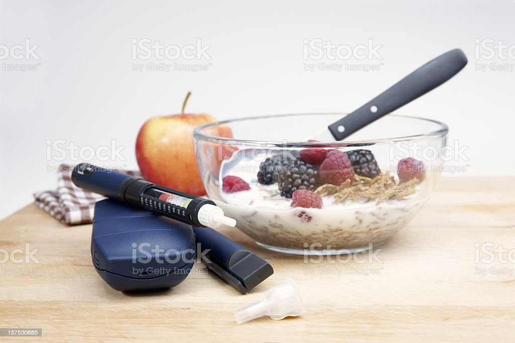 Diabetic medical equipment and a suitably healthy breakfast royalty-free stock photo