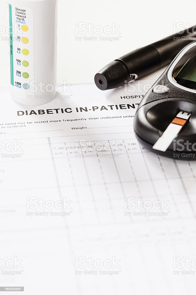 Diabetic medical form, glucometer, test strips, automatic lancet stock photo